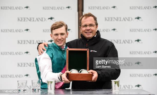 Kildare Ireland 9 August 2019 Jockey Colin Keane left and trainer Ger Lyons after winning The Keeneland Phoenix Stakes at The Curragh Racecourse in...
