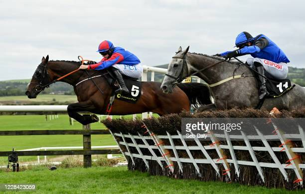 Kildare Ireland 9 September 2020 Ellie Mac left with Rachael Blackmore up jumps the last ahead of eventual second place Mister Fogpatches with Danny...