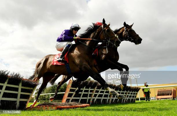 Kildare Ireland 9 September 2020 Military Star left with Harry cleary up and Deealli with Chris Timmons up jump the last during the Westgrove Hotel...