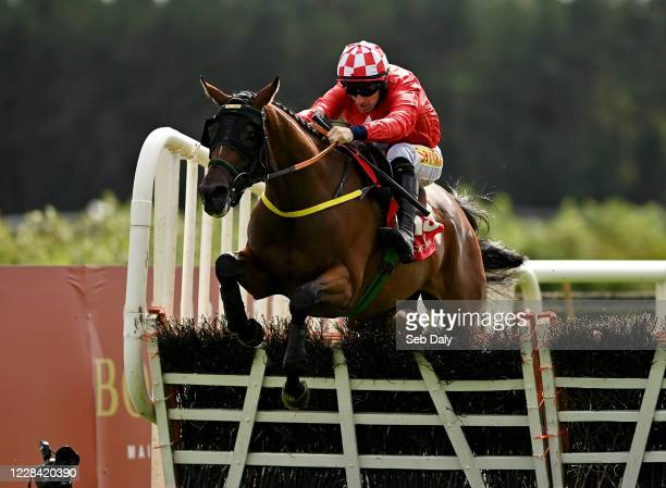 Kildare Ireland 9 September 2020 Red Gerry with Sean Flanagan up jumps the last on their way to winning the Westgrove Hotel Maiden Hurdle at...