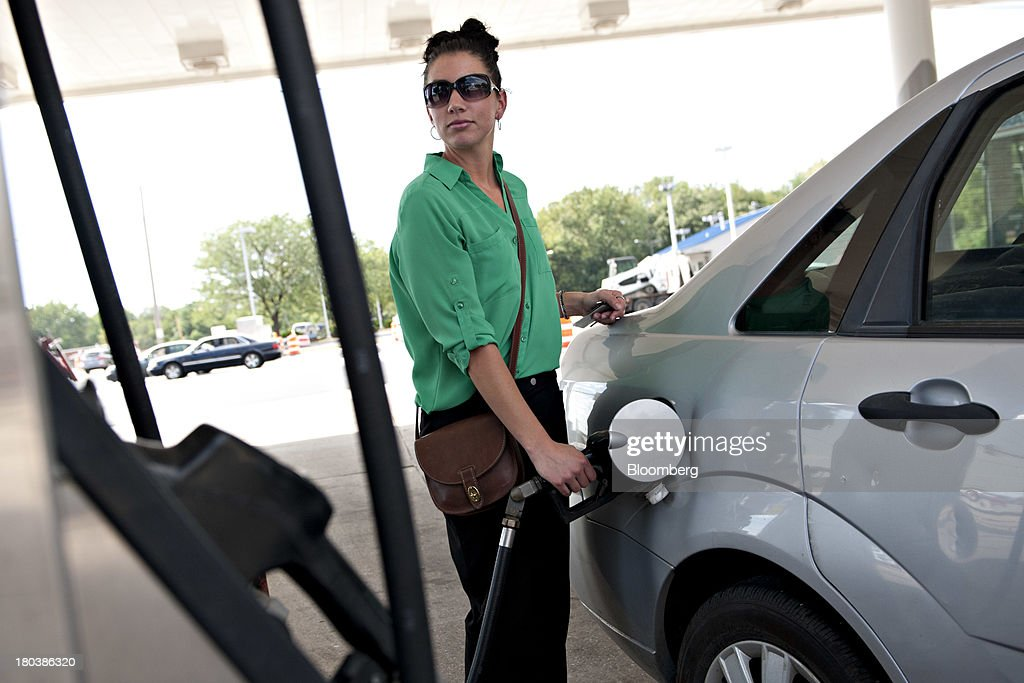 Kiley Harper fills her tank at a gas station in Peoria, Illinois, U.S., on Wednesday, Sept. 11, 2013. Gasoline climbed in New York trading as crude advanced before talks between the U.S. and Russia over disposing of Syrias chemical weapons and as U.S. jobless claims dropped. Photographer: Daniel Acker/Bloomberg via Getty Images