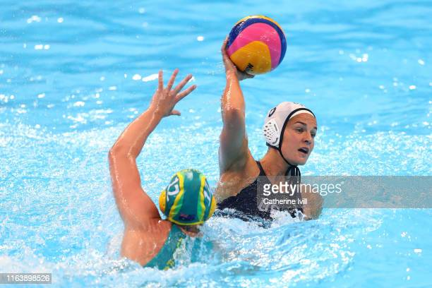 Kiley Neushul of the United States passes the ball against Madeleine Steere of Australia during the Women's Water Polo Semifinal match on day twelve...