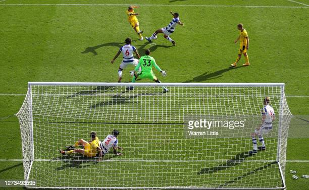 Kilian Ludewig of Barnsley has his shot at goal defended by Andy Rinomhota of Reading during the Sky Bet Championship match between Reading and...