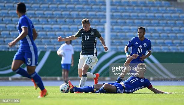 Kilian Ludewig of Germany and Eden Karzev of Israel vie for the ball during the Under 17 four nations tournament match between U17 Germany and U17...