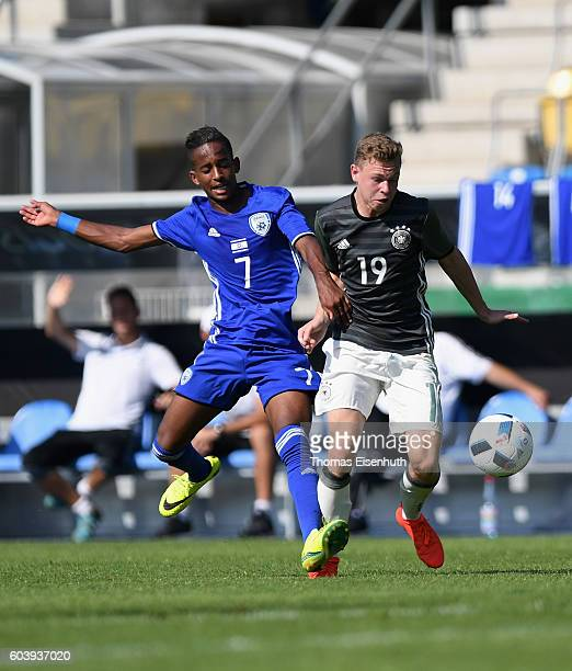 Kilian Ludewig of Germany and Yoni Sisay of Israel vie for the ball during the Under 17 four nations tournament match between U17 Germany and U17...