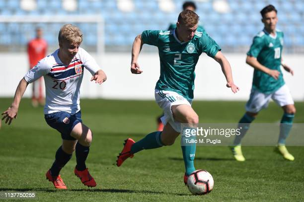 Kilian Ludewig of Germany is challenged by Edvard Tagseth of Norway during the UEFA Elite Round match between Norway U19 and Germany U19 at Gradski...