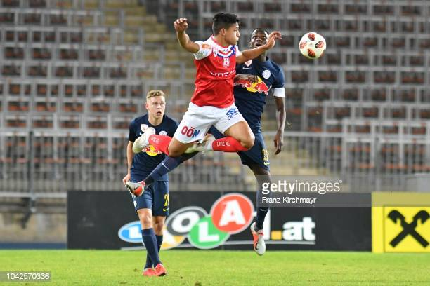 Kilian Ludewig of Liefering Alan Lima Carius of FC Linz and Mahamadou Dembele of Liefering compete for the ballduring the 2 Liga match between FC...