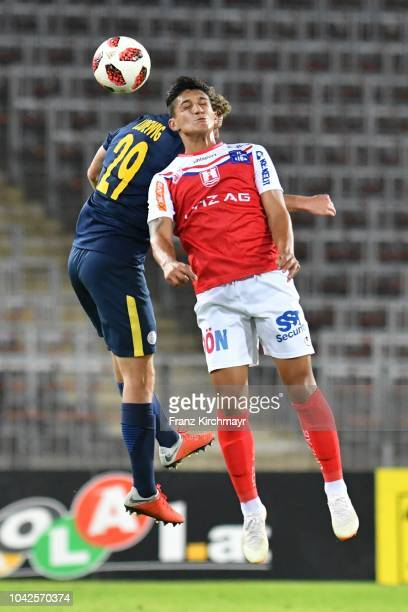 Kilian Ludewig of Liefering and Alan Lima Carius of FC Linz head the ball during the 2 Liga match between FC Blau Weiss Linz v FC Liefering at TGW...