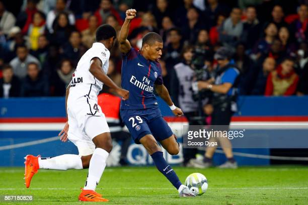 Kilian Mbappe of Paris Saint Germain and Santos Marlon of OGC Nice during the Ligue 1 match between Paris Saint Germain and OGC Nice at Parc des...