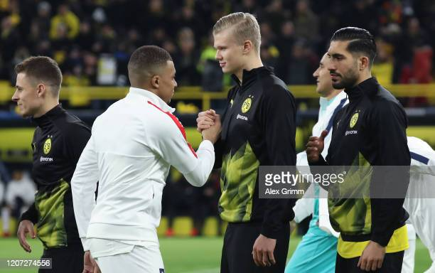 Kilian Mbappe of Paris SaintGermain shakes hands with Erling Haaland of Dortmund prior to the UEFA Champions League round of 16 first leg match...