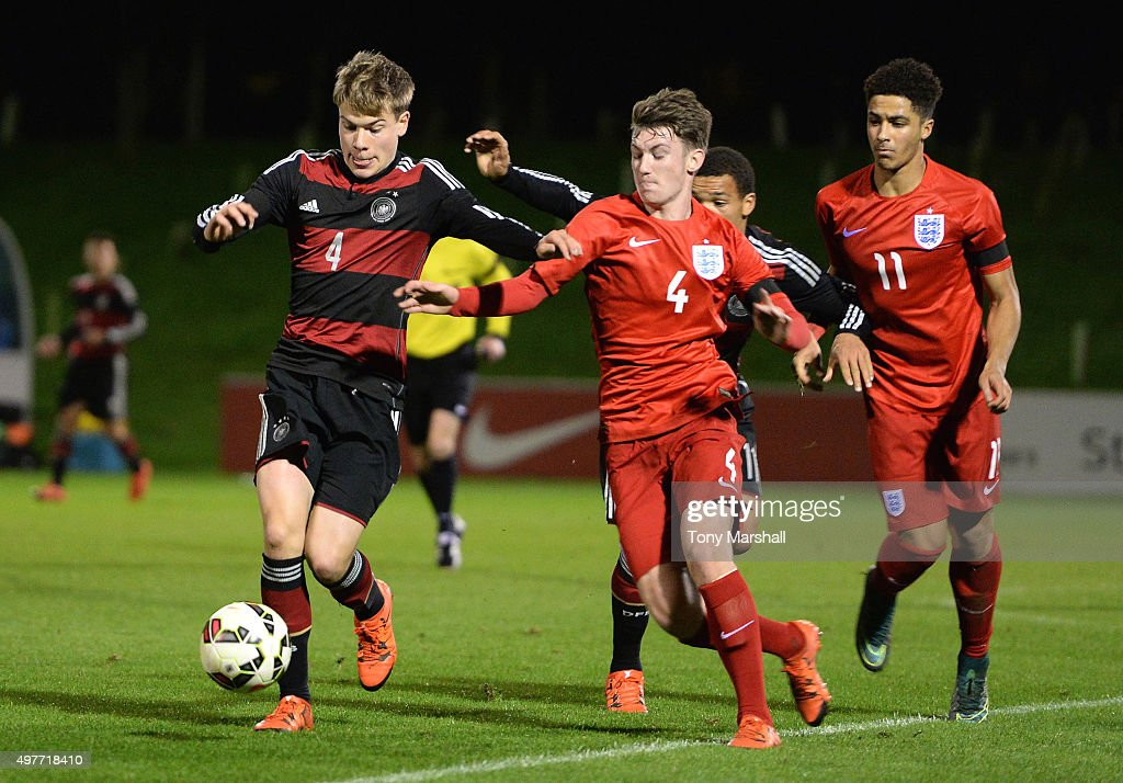 Kilian Senkbeil of Germany is tackled by Callum Slattery of England during the U17s International Friendly match between England U17 and Germany U17 at St Georges Park on November 18, 2015 in Burton-upon-Trent, England.