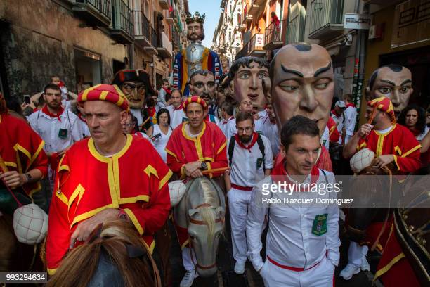 Kilikis big heads amid revellers take part in the Comparsa de Gigantes y Cabezudos or Giants and Big Heads parade on the second day of the San Fermin...