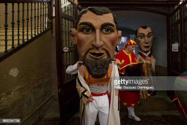 Kilikis prepare for the start of the Comparsa de Gigantes y Cabezudos or Giants and Big Heads parade on the second day of the San Fermin Running of...