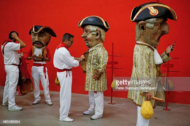 Kilikis' prepare to start the the Comparsa de Gigantes y Cabezudos 'Giants and Big Heads parade' on July 12, 2015 in Pamplona, Spain. The annual...