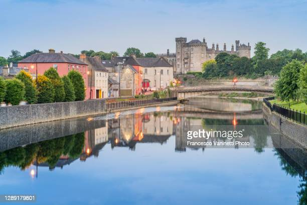 kilkenny castle and john's bridge at dusk, ireland. - ireland stock pictures, royalty-free photos & images