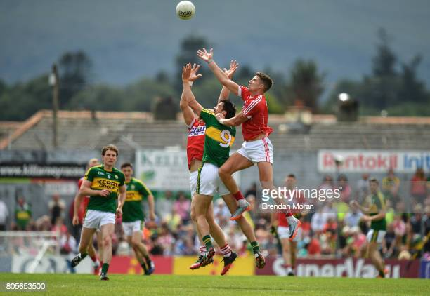 Killarney Ireland 2 July 2017 Aidan Walsh right and Alan O'Connor of Cork contest a high ball with Anthony Maher of Kerry during the Munster GAA...