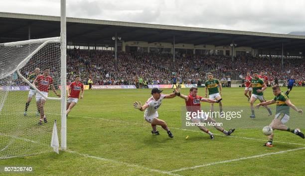 Killarney Ireland 2 July 2017 James O'Donoghue of Kerry has his shot on goal blocked by Cork goalkeeper Ken O'Halloran and James Loughrey during the...
