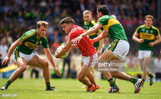 Killarney Ireland 2 July 2017 Sean Powter of Cork in action against Donnchadh Walsh left and Anthony Maher of Kerry during the Munster GAA Football...
