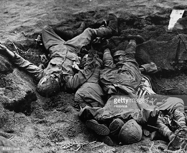 Killed by a Yank shell Japanese soldiers lie dead in the shell hole near the airfield at Iwo Jima ca 1945