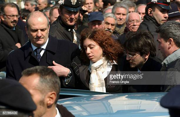 Killed Italian intelligence officer Nicola Calipari's daughter leaves Santa Maria Degli Angeli Basilica at the end of the State funeral on March 7,...