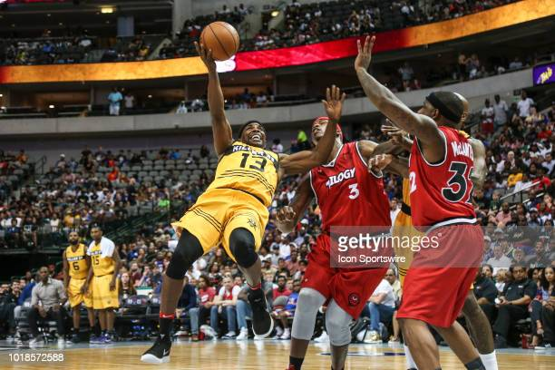 Killer 3's Mike James battles against Trilogy Al Harrington under the basket during the Big 3 Basketball playoff game between the Trilogy and the...