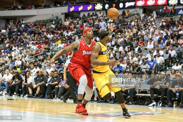 Killer 3's Stephen Jackson tries to dribble around Trilogy Al Harrington during the Big 3 Basketball playoff game between the Trilogy and the Killer...