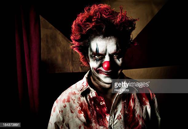 killer clown with an evil smile - clown's nose stock photos and pictures