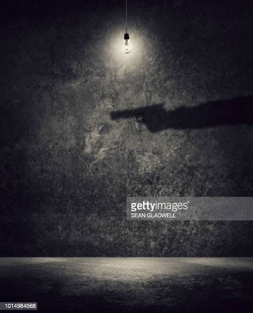 killer in the shadows - shooting crime stock pictures, royalty-free photos & images