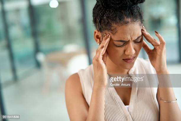 killer migraine courtesy of major work stress - headache stock pictures, royalty-free photos & images