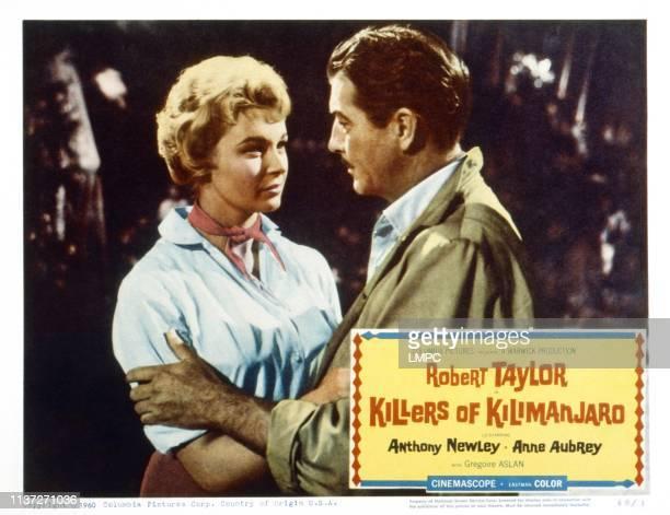 Killers Of Kilimanjaro US lobbycard from left Anne Aubrey Robert Taylor 1959