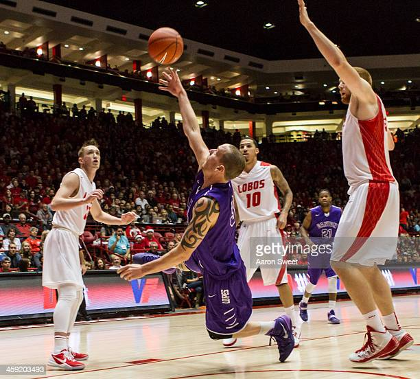 Killian Larson of the Grand Canyon Antelopes shoots for two against the New Mexico Lobos at The Pit on December 23 2013 in Albuquerque New Mexico New...