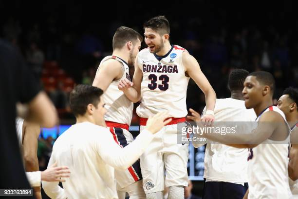 Killian Tillie and Corey Kispert of the Gonzaga Bulldogs celebrate defeating the Ohio State Buckeyes 9084 in the second round of the 2018 NCAA Men's...
