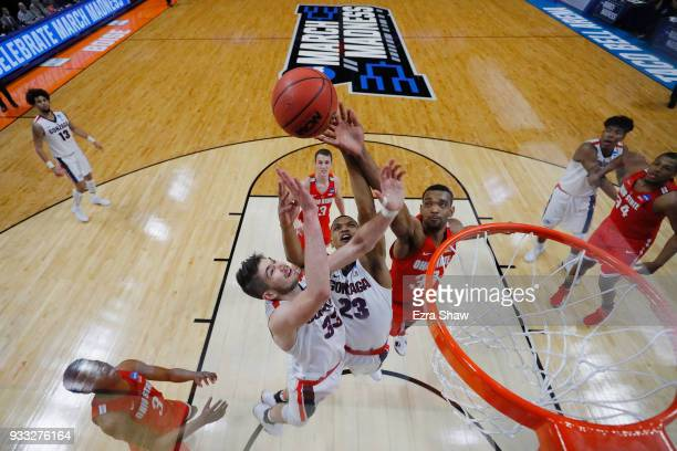 Killian Tillie and Zach Norvell Jr #23 of the Gonzaga Bulldogs battle for a rebound with Keita BatesDiop of the Ohio State Buckeyes in the second...