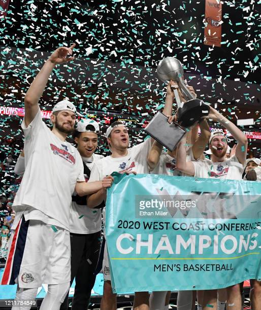 Killian Tillie Anton Watson Corey Kispert and Drew Timme of the Gonzaga Bulldogs celebrate with the trophy after defeating the Saint Mary's Gaels...