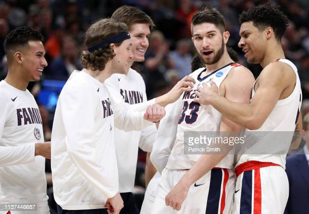 Killian Tillie of the Gonzaga Bulldogs celebrates with teammates as they play against the Fairleigh Dickinson Knights during the first half in the...