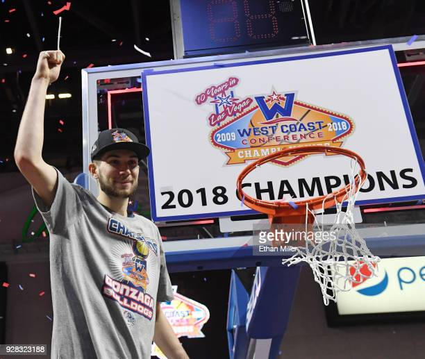 Killian Tillie of the Gonzaga Bulldogs cuts down a net after defeating the Brigham Young Cougars 7454 to win the championship game of the West Coast...