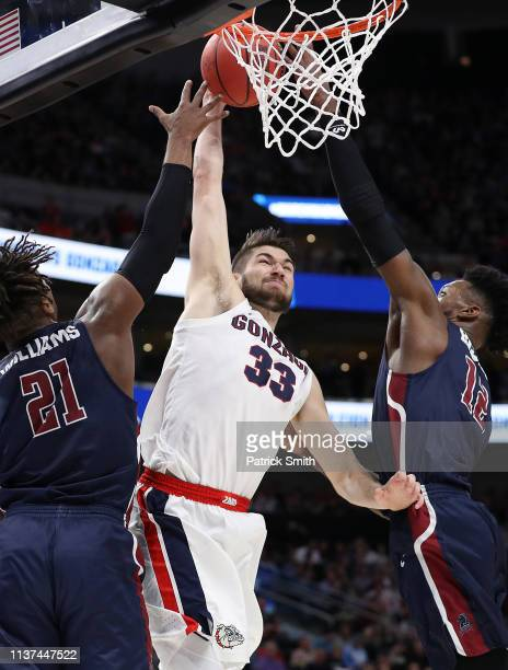 Killian Tillie of the Gonzaga Bulldogs dunks against Elyjah Williams and Kaleb Bishop of the Fairleigh Dickinson Knights during the second half in...