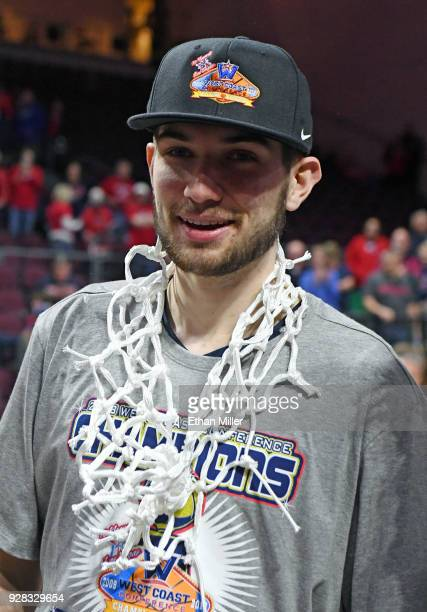 Killian Tillie of the Gonzaga Bulldogs wears a net the team cut down after defeating the Brigham Young Cougars 7454 to win the championship game of...