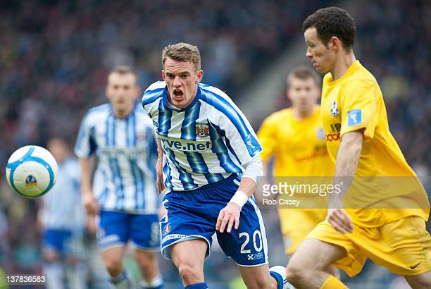 Killie's Dean Shiels and Ayr's Eddie Malone eye the ball during the Scottish Communities Cup Semi Final match between Ayr United and Kilmarnock at...