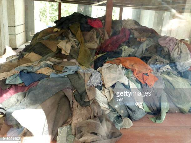 Killing Field-Cambodian genocide. Clothes of the victims at the Killing Field of Choeung Ek. The Killing Fields are a number of sites in Cambodia...