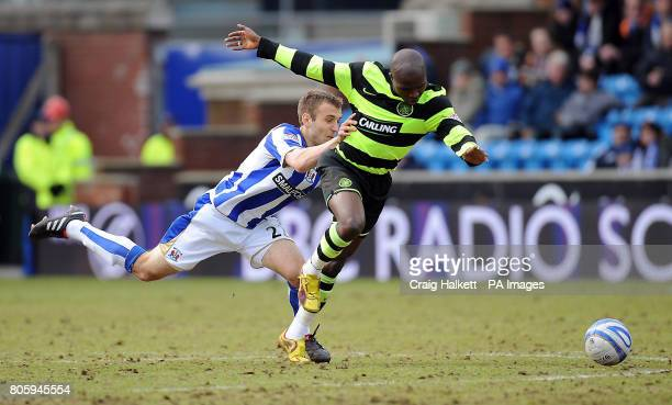 Kilmarncok's Liam Kelly and Celtic's Landry N'Guemo battle for the ball during the Active Nation Scottish Cup match at Rugby Park Kilmarnock