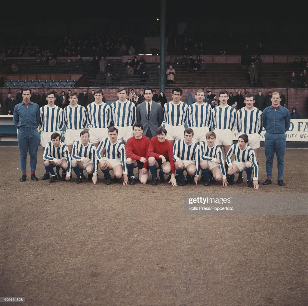 Kilmarnock FC 1968-69 team squad players pictured together on the pitch at Rugby Park stadium in Kilmarnock, Scotland in 1969. Back row from left to right: John Murdoch (trainer), Cammy Evans, Robin Arthur, John Gilmour, Jim McFadzean, manager Walter McCrae, Frank Beattie, Jackie McGrory, Brian Rodman, Billy Dickson and trainer Hugh Allan. Front row from left to right: Tommy McLean, Brian McIlroy, Andy King, Sandy McLaughlan, Ian Dick, Eddie Morrison, Billy Sinclair and Jim Cook.