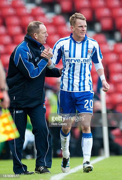 Kilmarnock manager Kenny Shiels congratulates his son Dean after he scored the winning goal during the Scottish Communities Cup Semi Final match...
