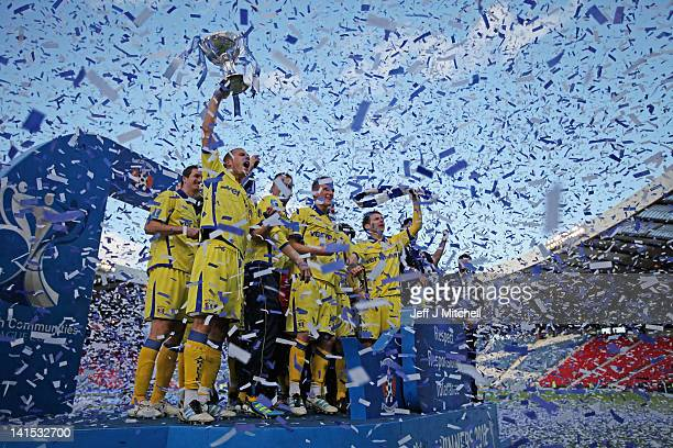 Kilmarnock players celebrate after beating Celtic 10 in the Scottish Communities League Cup Final between Celtic and Kilmarnock at Hampden Park on...