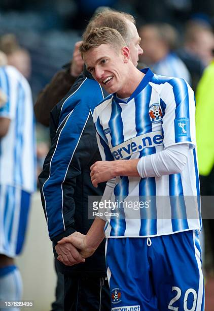 Kilmarnock scorer Dean Shiels shakes hands with assistant manager Jimmy Nichol at the end of the Scottish Communities Cup Semi Final match between...