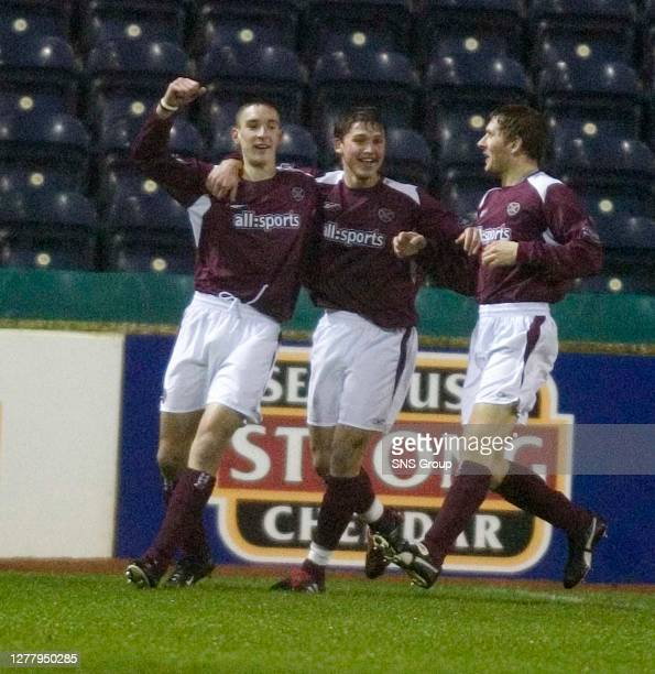 Edinburgh youngster Lee Wallace , celebrates his goal for Hearts with Saulius Mikoliunas and Dennis Wyness .