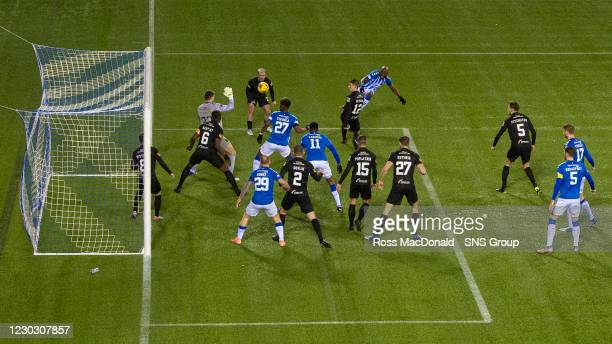 Kilmarnock's Youssouf Mulumbu has a chance saved by Livingston goalkeeper Max Stryjek during the Scottish Premiership match between Kilmarnock and...