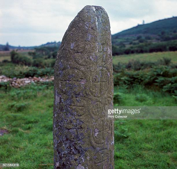 Kilnasaggart cross an inscribed pillar This is the oldest datable Christian monument in Ireland One one side it bears ten crosses each inscribed in a...