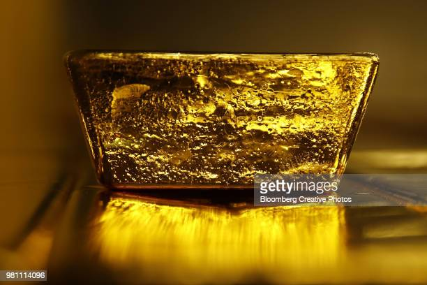 a 12.5 kilogram gold bullion bar - gold bars stock photos and pictures