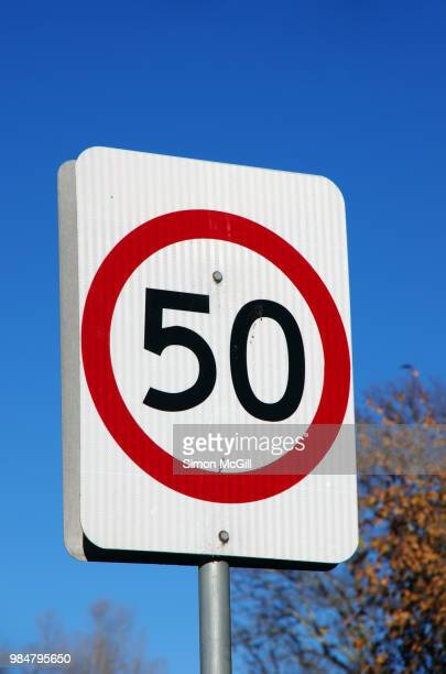 50 kilometres per hour speed limit sign - speed limit sign stock photos and pictures